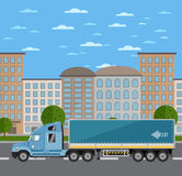 Commercial freight truck on road in city Stock Images