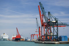 Commercial Harbor. Red and black cargo cranes in a commercial harbor Stock Images