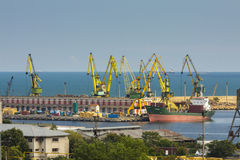 Commercial harbor with cargo ship and cranes Stock Photography
