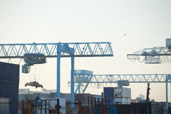Commercial harbor with industrial cranes Stock Image