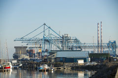 Commercial harbor with industrial cranes Royalty Free Stock Photos