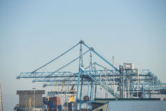 Commercial harbor with industrial cranes Stock Images