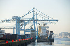 Commercial harbor with industrial cranes Stock Photo