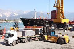 Commercial harbor with truck forklift and ship Royalty Free Stock Image