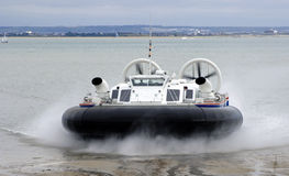 Commercial Hovercraft. A commercial passenger hovercraft comes ashore Stock Photos