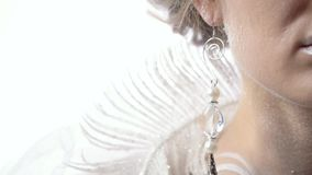 Close up of the icy earring, winter commercial, snow queen. Commercial, ice earring, body art and makeup, close up on white background stock video