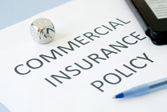 Commercial insurance. Policy on blue background Stock Photos
