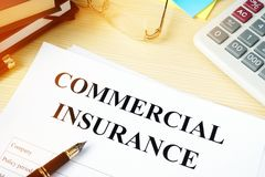Commercial insurance policy on a desk. Royalty Free Stock Photography