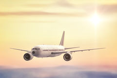 Commercial Jet. A commercial Jet flying high above the clouds into the sunset Royalty Free Stock Photo