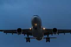Commercial jet airliner in flight at night Stock Images
