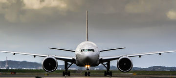 Commercial jet airliner in front view. Commercial passenger jet airliner on runway in front view Royalty Free Stock Photography