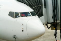 Commercial jet airliner at loading dock Stock Photo