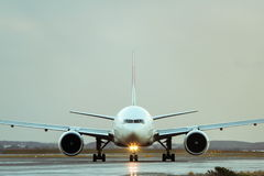 Commercial jet airliner on runway. Front view Stock Photos