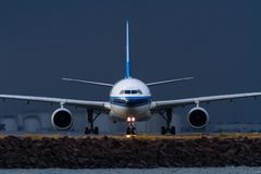 Commercial jet airliner on the runway in front view Royalty Free Stock Images