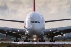 Commercial jet airliner on the runway in front view Royalty Free Stock Photo