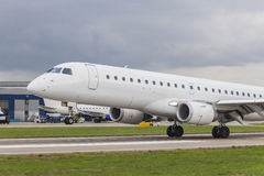 Commercial Jet Airplane Landing on an Airport Runway Stock Images