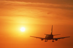 Free Commercial Jet Flying Into Sunset Royalty Free Stock Image - 23148386