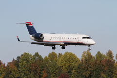 Commercial Jet Landing Above Trees Stock Photography