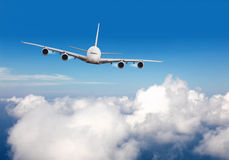Commercial jet plane flying above clouds Royalty Free Stock Image