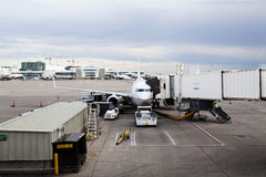 Commercial Jet Plane At Jetway Loading Luggage Stock Image