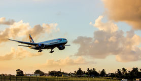 Commercial Jet plane about to land around Sunset in Barbados Royalty Free Stock Image