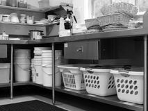 Commercial kitchen: laundry baskets. Commercial kitchen with laundry baskets under stainless steel bench - black and white Stock Images