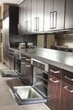 Commercial Kitchen With Open Oven And Cabinets Royalty Free Stock Image
