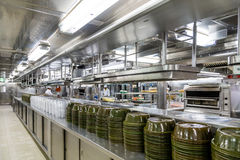 Commercial Kitchen with Serving Domes. Stacks of Empty Serving Dishes in Commercial Kitchen Stock Photography