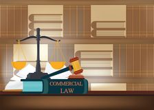 Commercial law books on a table and blurred bookshelves. Commercial law books on a table and blurred bookshelves background with a judge`s gavel , judicial and Royalty Free Stock Photo