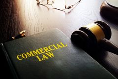 Commercial law and gavel. Commercial law and gavel on a table Royalty Free Stock Images