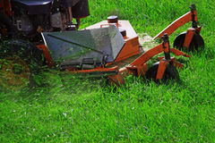 Mowing Green Lawn stock image