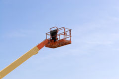 Commercial Lift. A modern cherry picker or lift for use in commercial construction or painting Royalty Free Stock Images