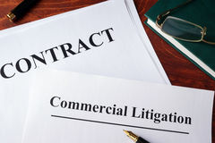 Commercial litigation form. Commercial litigation form and contract on a table stock photography