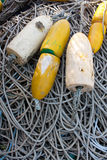 Commercial Marker Buoys. Yellow and white commercial marker buoys on a tangle of rope Royalty Free Stock Image