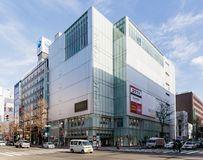 Commercial modern building with cars moving on the road in Sapporo in Hokkaido, Japan.  stock photo
