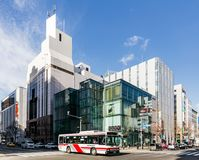 Commercial modern building with moving bus on the road in Sapporo in Hokkaido, Japan.  stock image
