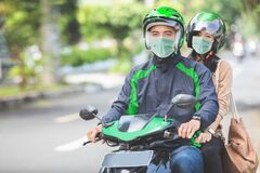 Free Commercial Motorcycle Taxi Driver Taking His Passenger To Her De Stock Photos - 178865553