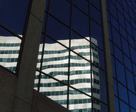 Commercial office building distorted reflections in Winnipeg Canada. CAN Stock Photos