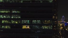 Commercial office buildings exterior. Shot. Night view at skyscrapers. Top view of office building at night royalty free stock photos