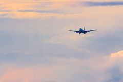 Commercial passenger airplane coming in for landing during beaut Stock Images