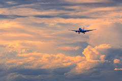 Commercial passenger airplane coming in for landing during beaut Royalty Free Stock Image