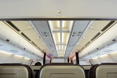Commercial passengers airplane interior Royalty Free Stock Photo