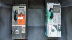Commercial payphone reminders of the pre-cellular age Royalty Free Stock Photography