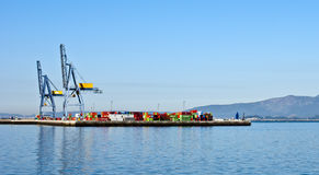 Commercial port. Vilagarcia de Arousa, Spain - October 12, 2011 - Commercial port with cranes and containers located in Vilagarcia de Arousa Royalty Free Stock Photos