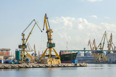 Commercial port with cargo ship and cranes Stock Photo