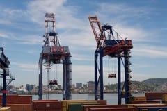 Commercial Port Cranes of Rio de Janeiro. Rio de Janeiro, Brazil - January 18, 2018: Port cranes along the Rio-Niteroi bridge. Skyline and mountains of the city Royalty Free Stock Photos