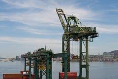 Commercial Port Cranes of Rio de Janeiro. Rio de Janeiro, Brazil - January 18, 2018: Port cranes along the Rio-Niteroi bridge. Skyline and mountains of the city Royalty Free Stock Images