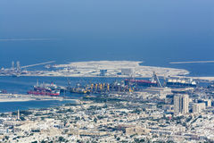 Commercial port Dubai. Commercial port with ships, Foreground Al Mina and in the background Dubai Maritime City. UAE, united Ara Emirates Stock Image