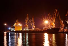 Commercial port at night. Commercial port and ships at night. Long exposure Stock Photo