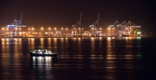Commercial port view at night Stock Photos